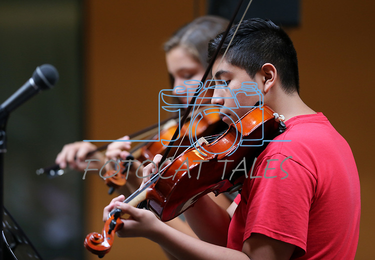 Quinn Pulver, 14, left, and Christian Rodriguez, 13, perform a duet in the Carson City Symphony's Youth Strings Summer Program concert in Carson City, Nev., on Thursday, July 27, 2017. <br /> Photo by Cathleen Allison