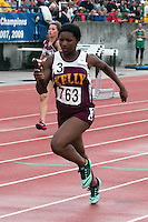 Kelly's Dakaria Johnson runs a leg of the 3rd place 4x100 relay that finished in 50.89.