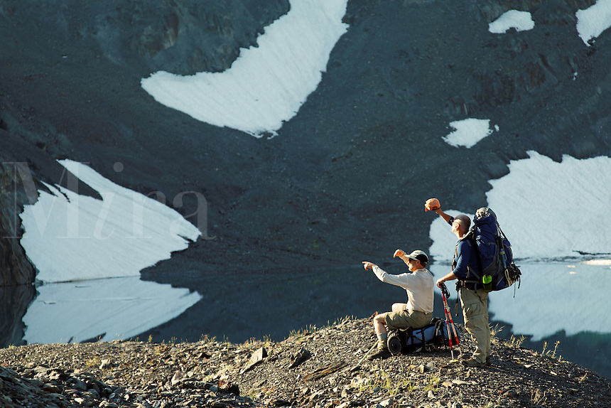 Backpackers scouting route in upper Ferry Basin, Bailey Range Traverse, Olympic Mountains, Washington