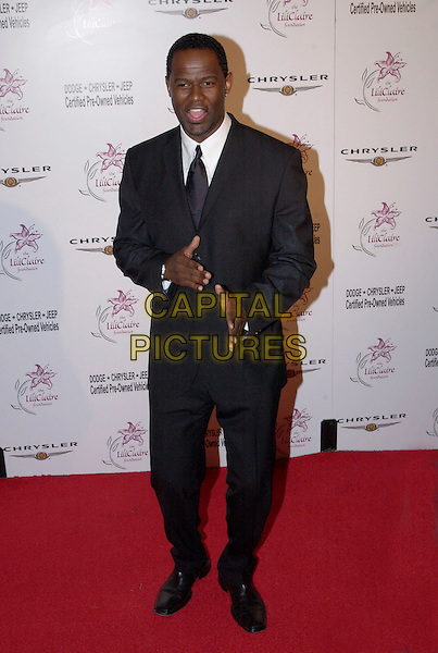 BRIAN MCKNIGHT.attends the 6th Annual Lili Claire Foundation Benefit held at The Beverly Hilton Hotel.full length, full-length, hand gesture.www.capitalpictures.com.sales@capitalpictures.com.©Capital Pictures.