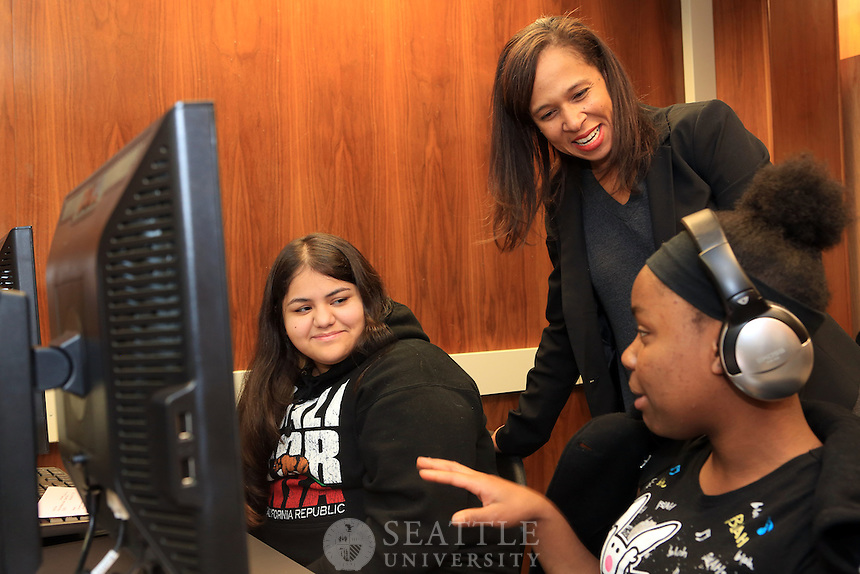 12042012-  Middle College High School at Seattle University..Charisse Cowan Pitre, an associate professor in the College of Education at Seattle University talks with Middle College High School senior Kymberli Gonzalez, left, and sophomore Nahje Taylor-Woods about thier recent mock trial that took place at the King County Court House.