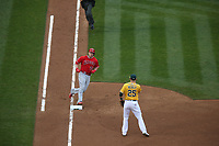OAKLAND, CA - APRIL 6:  Mike Trout #27 of the Los Angeles Angels of Anaheim runs to first base against the Oakland Athletics during the game at the Oakland Coliseum on Thursday, April 6, 2017 in Oakland, California. (Photo by Brad Mangin)