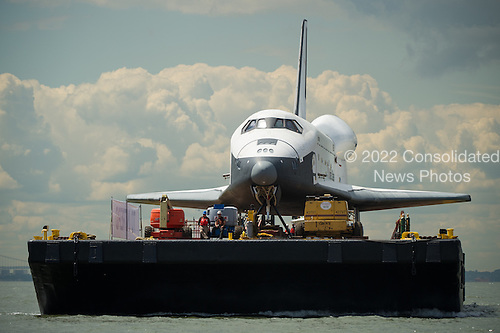 The space shuttle Enterprise is towed by barge up the Hudson River on it's way to the Intrepid Sea, Air and Space Museum where it will be permanently displayed, Wednesday, June 6, 2012 in New York City. .Mandatory Credit: Bill Ingalls / NASA via CNP