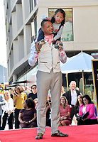 LOS ANGELES, USA. September 24, 2019: Terrence Howard & son  at Hollywood Walk of Fame Star Ceremony for actor Terrence Howard.<br /> Picture: Paul Smith/Featureflash