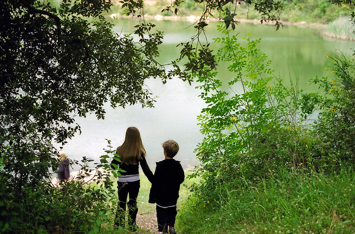 Children find a lake in the Italian countryside.