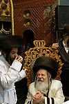 Israel, Bnei Brak, the Rabbi of Premishlan congregation offers wine and blessing on the festive day of Purim