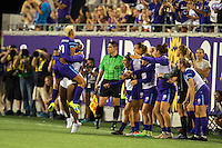 Orlando, Florida - Saturday, April 23, 2016: Orlando Pride forward Lianne Sanderson (10) jumps into the arms of a teammate and celebrates her free kick goal during an NWSL match between Orlando Pride and Houston Dash at the Orlando Citrus Bowl.  The goal gave Orlando a 2-0 lead.