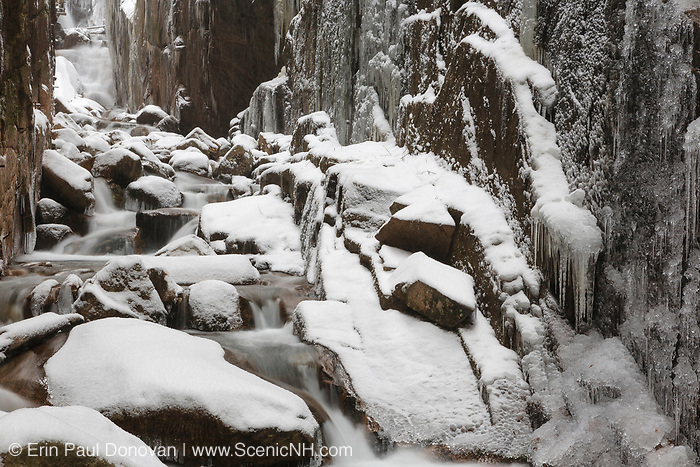 Flume Gorge in Franconia Notch, New Hampshire USA during a snow-storm. Blowing snow can be seen in the photo.