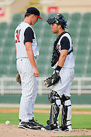Catcher Rafael Vera #37 of the Kannapolis Intimidators has a chat with relief pitcher Chris Bassitt #31 during the South Atlantic League game against the Delmarva Shorebirds at Fieldcrest Cannon Stadium on August 7, 2011 in Kannapolis, North Carolina.  The Intimidators defeated the Shorebirds 8-3.   (Brian Westerholt / Four Seam Images)