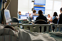 The NICU team has a meeting discussing patient cases during rounds in the Neonatal Intensive Care Unit at Boston Children's Hospital in Boston, Mass., on Mon., June 13, 2016. Patient space, family space, and work space is all crowded together in the current NICU. The NICU will be greatly expanded under building plans for the hospital, but those plans will eliminate the Prouty Garden, a half-acre of green space at the hospital that many in the hospital community hold dear.