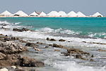 Bonaire, Netherlands Antilles; large, white piles of sea salt at the Cargill Salt Bonaire production facility on the southern part of the island, viewed from the beach, just north of the production plant , Copyright © Matthew Meier, matthewmeierphoto.com All Rights Reserved