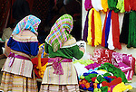 Flower Hmong Wool Stall - Flower Hmong women choosing wool at a stall in the weekly Bac Ha town market, in the mountainous northwest of Viet Nam.