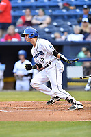 Asheville Tourists catcher Robbie Perkins (11) swings at a pitch during a game against the Rome Braves at McCormick Field on May 22, 2017 in Asheville, North Carolina. The Braves defeated the Tourists 7-3. (Tony Farlow/Four Seam Images)
