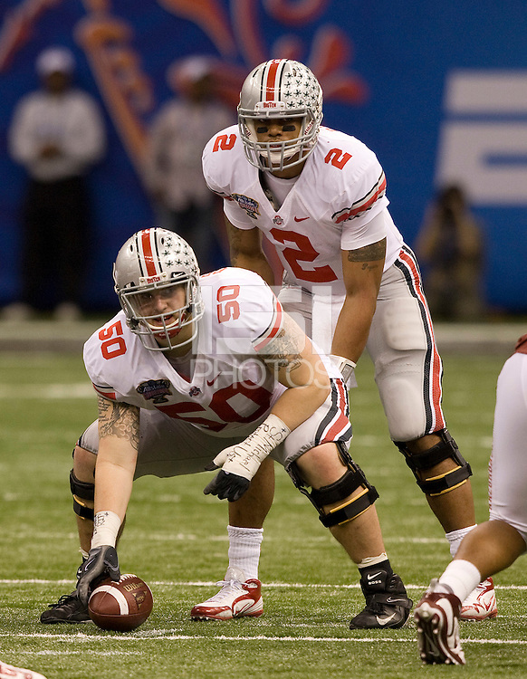 Mike Brewster of Ohio State and Terrelle Pryor of Ohio State in action against Arkansas during 77th Annual Allstate Sugar Bowl Classic at Louisiana Superdome in New Orleans, Louisiana on January 4th, 2011.  Ohio State defeated Arkansas, 31-26.