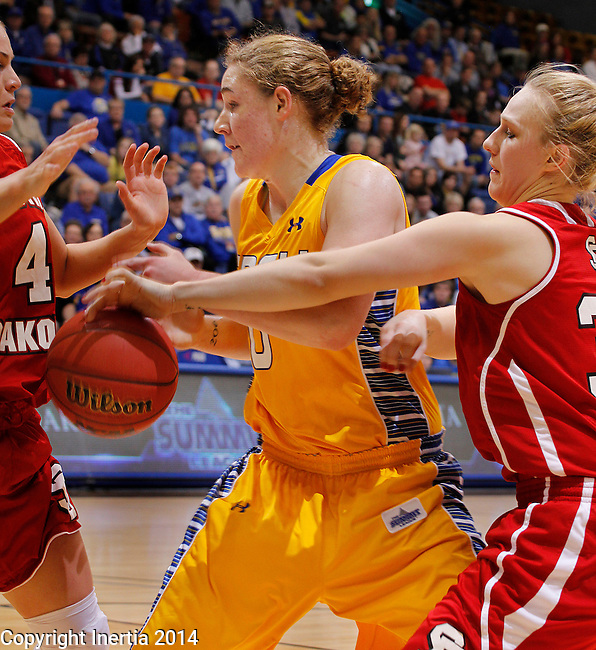 SIOUX FALLS, SD - MARCH 10:  Nicole Seekamp #30 (right) of South Dakota swats the ball from Chynna Stevens #0 of South Dakota State during their semifinal game at the 2014 Summit League Basketball Championships at the Sioux Falls Arena Monday.  (Photo by Dick Carlson/Inertia)