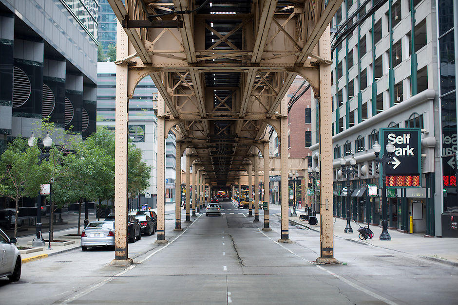 """The underside of the """"L"""" elevated train tracks are seen in the Loop on Sunday, Aug. 30, 2015, in Chicago. (Photo by James Brosher)"""