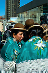 Bolivian cholitas dressed in bowler hats and mantas or shawls, the traditional indigenous Aymaran dress, celebrating Bolivian Independence Day in La Paz, Bolivia.