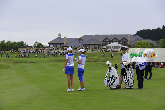 Meghan Maclaren and Maria Dunne on the 18th during the Friday morning foursomes at the 2016 Curtis cup from Dun Laoghaire Golf Club, Ballyman Rd, Enniskerry, Co. Wicklow, Ireland. 10/06/2016.<br /> Picture Fran Caffrey / Golffile.ie<br /> <br /> All photo usage must carry mandatory copyright credit (&copy; Golffile | Fran Caffrey)