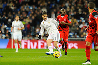 Real Madrid´s Isco and Sevilla's Stephane Mbia during 2014-15 La Liga match between Real Madrid and Sevilla at Santiago Bernabeu stadium in Alcorcon, Madrid, Spain. February 04, 2015. (ALTERPHOTOS/Luis Fernandez) /NORTEphoto.com