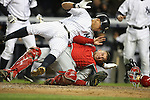 The Yankee's Alex Rodriguez collides with the Angels' Jeff Mathis in the bottom of the 5th inning after Hideki Matsui hit a double scoring one run and Rodriguez getting out at the plate during game one of the American League Championship Series at Yankee Stadium on Friday, Oct. 16, 2009.