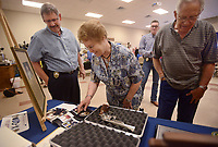 NWA Democrat-Gazette/BEN GOFF @NWABENGOFF<br /> Ken Farmer (left), Bella Vista Police Chief, talks with Gloria Sayre and husband Robert Sayre of Bella Vista as they take a look at some of the commemorative items presented to Farmer Friday, May 19, 2017, during a retirement ceremony and reception for Farmer at American Legion Post  341 in Bella Vista. Farmer began his law enforcement career in 1978 with the Benton County Sheriff's Office, working in the sheriff's office Bella Vista Division. Farmer started as a captain with the Bella Vista Police Department after the city incorporated in 2007, and became the department's chief in October 2009. James Graves has been hired as incoming chief, and will take over full responsibility as chief on June 1.