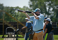 NWA Democrat-Gazette/BEN GOFF @NWABENGOFF<br /> John Langford of Hot Springs fires at a clay Friday, June 16, 2017, during the Poultry Festival trap competition at the Bella Vista Property Owners Association gun range. The 58th annual Poultry Festival is a fundraiser for The Poultry Federation, and also includes a golf tournament and scholarship auction Friday and a concert at the Walmart Arkansas Music Pavillion and poultry cook off on Saturday in Rogers.