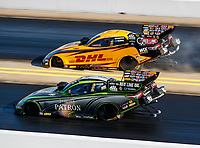 Sep 16, 2017; Concord, NC, USA; NHRA funny car driver Alexis DeJoria (near) races alongside teammate J.R. Todd during qualifying for the Carolina Nationals at zMax Dragway. Mandatory Credit: Mark J. Rebilas-USA TODAY Sports