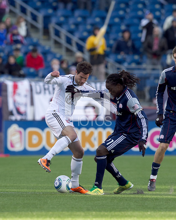DC United forward Chris Pontius (13) and New England Revolution midfielder Shalrie Joseph (21) battle for the ball. In a Major League Soccer (MLS) match, the New England Revolution defeated DC United, 2-1, at Gillette Stadium on March 26, 2011.