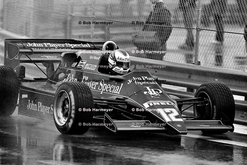 DETROIT, MI - JUNE 5: Nigel Mansell of Great Britain drives the Lotus 92 10/Ford Cosworth DFV during a wet practice session for the Detroit Grand Prix FIA Formula 1 race on the temporary street circuit in Detroit, Michigan, on June 5, 1983.