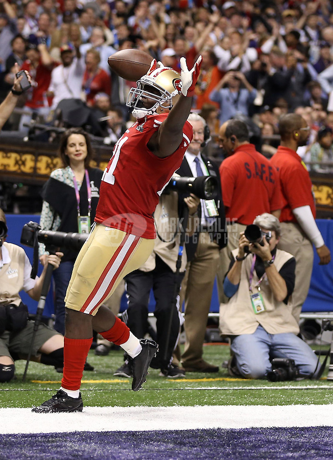 Feb 3, 2013; New Orleans, LA, USA; San Francisco 49ers running back Frank Gore (21) celebrates after scoring a touchdown against the Baltimore Ravens in the third quarter during Super Bowl XLVII at the Mercedes-Benz Superdome.  Mandatory Credit: Mark J. Rebilas-