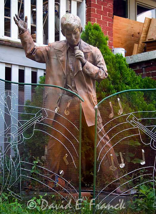 Elvis Presley statue at the Mini Graceland replica in a yard in Roanoke Virginia