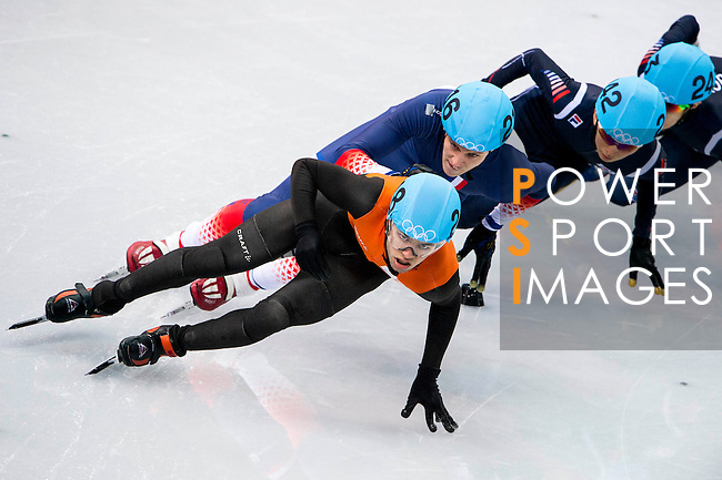 Sjinkie Knegt of Netherlands being followed by ( during the Short Track Speed Skating as part of the 2014 Sochi Olympic Winter Games at Iceberg Skating Palace on February 10, 2014 in Sochi, Russia. Photo by Victor Fraile / Power Sport Images