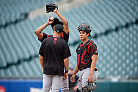 Indianapolis Indians pitching coach Bryan Hickerson (jacket) talks with pitcher Dario Agrazal (22) and catcher Steven Baron (44) during an International League game against the Buffalo Bisons on June 20, 2019 at Sahlen Field in Buffalo, New York.  Buffalo defeated Indianapolis 11-8  (Mike Janes/Four Seam Images)