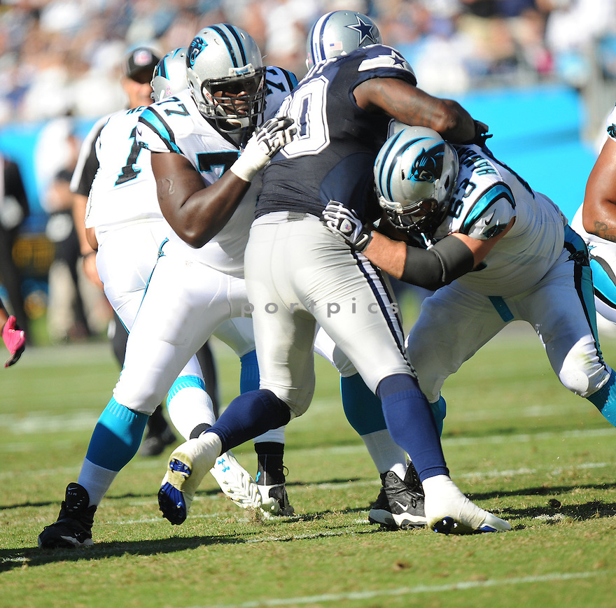 Carolina Panthers Byron Bell (77) in action during a game against the Cowboys on October 21, 2012 at Bank of America Stadium in Charlotte, NC. The Cowboys beat the Panthers 19-14.