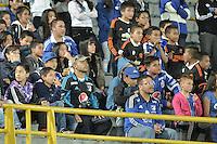 BOGOTA - COLOMBIA -07 -05-2016: Niños hichas de Millonarios animan a su equipo durante el encuentro entre Millonarios y Cortulúa por la fecha 17 de la Liga Águila I 2016 jugado en el estadio Nemesio Camacho El Campín de la ciudad de Bogotá./ Little fans of Millonarios cheer for their team during the match between Millonarios and Cortulua for the date 17 of the Aguila League I 2016 played at Nemesio Camacho El Campin stadium in Bogota city. Photo: VizzorImage / Gabriel Aponte / Staff.