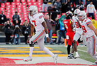 Ohio State Buckeyes quarterback Dwayne Haskins Jr. (7) celebrates his rushing touchdown against Maryland Terrapins during overtime of their game at Capital One Field at Maryland Stadium in College Park, Maryland on November 17, 2018. [Kyle Robertson/Dispatch]