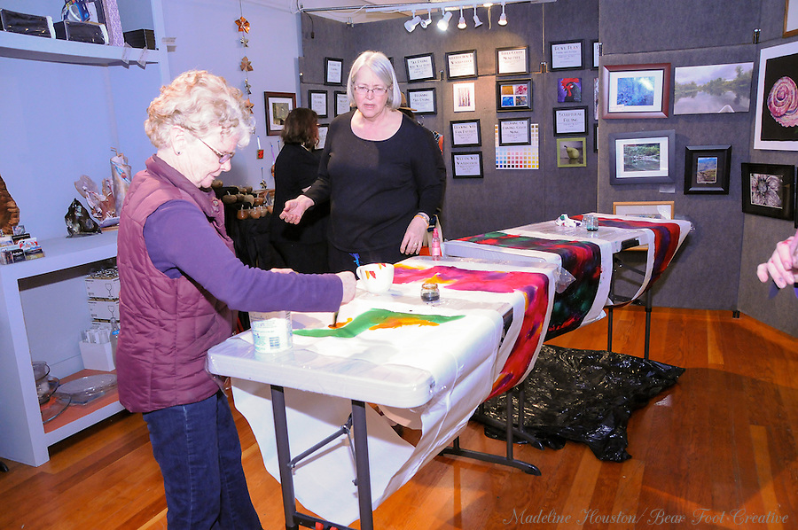 Artists Karen Leback and Di Morgan participate in a silk scarf painting class led by artist Sue Wachter at the Rectangle Gallery.<br />