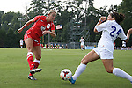 01 September 2013: New Mexico's Liz Nare (9) has a shot blocked by Duke's Mollie Pathman (24). The Duke University Blue Devils played the University of New Mexico Lobos at Fetzer Field in Chapel Hill, NC in a 2013 NCAA Division I Women's Soccer match. Duke won the game 1-0.
