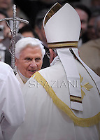 Pope Francis  is greeted by Pope emeritus Benedict XVI (L) during appointing new cardinals at the consistory in the St. Peter's Basilica at the Vatican on February 22, 2014.
