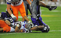 Jan. 4, 2010; Glendale, AZ, USA; TCU Horned Frogs defensive end (98) Jerry Hughes tackles Boise State Broncos running back (22) Doug Martin in the second quarter in the 2010 Fiesta Bowl at University of Phoenix Stadium. Mandatory Credit: Mark J. Rebilas-