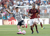 Calcio, Serie A: Roma vs Juventus. Roma, stadio Olimpico, 30 agosto 2015.<br /> Juventus' Paulo Dybala, left, is chased by Roma's Seydou Keita during the Italian Serie A football match between Roma and Juventus at Rome's Olympic stadium, 30 August 2015.<br /> UPDATE IMAGES PRESS/Isabella Bonotto