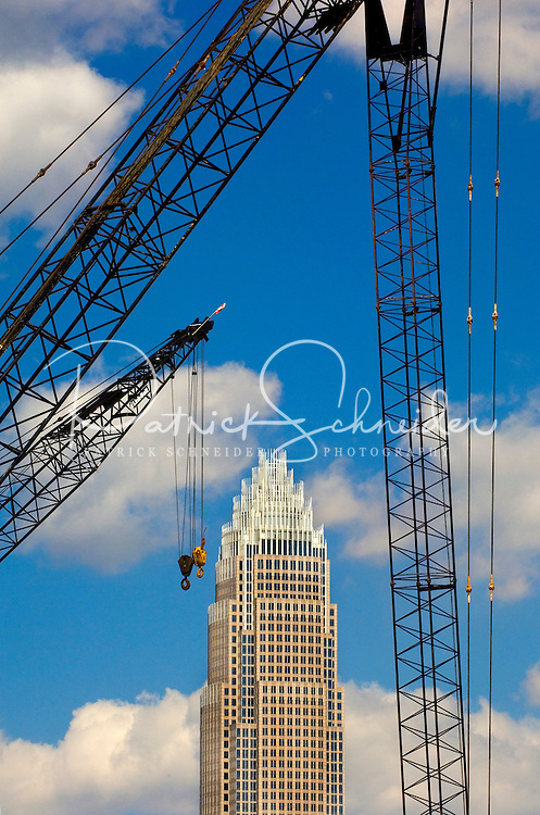 A construction crane frames the profile of Charlotte's Bank of America headquarters.