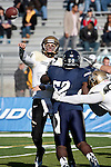 December 3, 2011:  Idaho quarterback Brian Reader throws over Nevada's James-Michael Johnson in the first quarter during a WAC league game played at Mackay Stadium in Reno, Nevada.