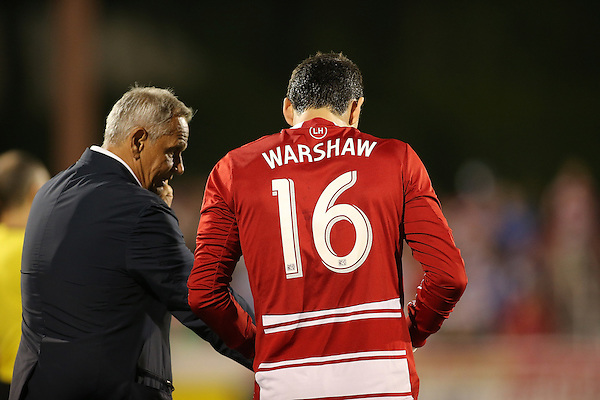 FRISCO, TX: Schellas Hyndman head coach of FC Dallas in talks with Bobby Warshaw #16 before going in during the second halfagainst the San Jose Earthquakes at FC Dallas Stadium in Frisco, Texas on May 25,2013 (Photo Rick Yeatts)