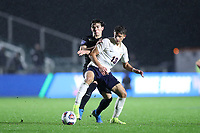 CARY, NC - DECEMBER 13: Bret Halsey #13 of University of Virginia plays the ball in front of Isaiah Parente #15 of Wake Forest University during a game between Wake Forest and Virginia at Sahlen's Stadium at WakeMed Soccer Park on December 13, 2019 in Cary, North Carolina.