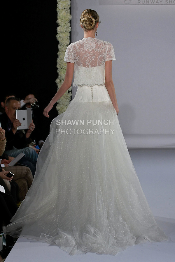 Model walks runway in a wedding dress from the Jesus Peiro collection by Merche Segarra, for the Couture Runway Show, during New York Bridal Fashion Week at The Hilton Hotel, October 13, 2012.