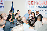 People crowd in to get an autograph from or picture with Republican presidential candidate Dr. Ben Carson after he spoke at a town hall campaign stop at a meeting of the Windham Republican Town Committee at the Castleton Banquet and Conference Center in Windham, New Hampshire.