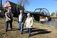 NWA Democrat-Gazette/DAVID GOTTSCHALK Benton County Judge Mary Moehring (from left) visits with Bob Tharp and his wife Joy Friday, November 1, 2019, after the placement of a strong currents warning sign on the bank of the War Eagle creek at the War Eagle Mill. The Tharp's son Ross died in a floating accident at the dam on the river in June of this year. Six signs, were placed by Benton County and Bob Tharp, the mayor of Decatur, in a collaborated project so others will be aware of the dangerous currents on the creek.