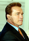 Washington, DC - February 23, 2004 -- Governor Arnold Schwarzenegger of California listens to United States President George W. Bush as he made remarks to a meeting of the National Governors Association in the State Dining Room at the White House in Washington, D.C. on February 23, 2004..Credit: Ron Sachs / CNP
