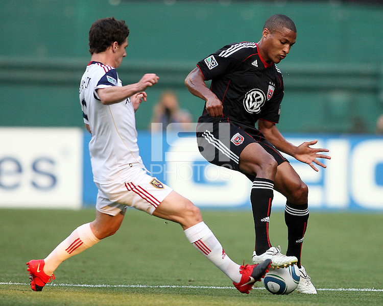 Jordan Graye #16 of D.C. United controls the ball as Will Johnson #8  of Real Salt Lake moves in during an Open Cup match at RFK Stadium, on June 2 2010 in Washington DC. DC United won 2-1.
